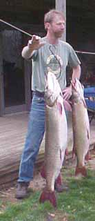 Ohio taxidermist Dan Jennings with a couple of muskies.