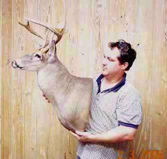 Louisiana taxidermist Paul Eymard and one of his whitetail taxidermy mounts.